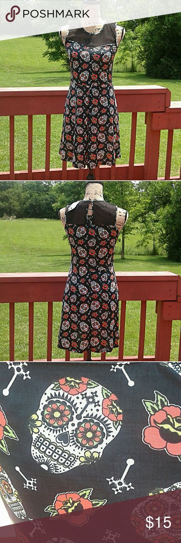 NWT Hot Topic sugar skull dress Cute black dress with sugar skulls pattern. Very flattering 95% polyesyer, 5% spandex Hot Topic Dresses