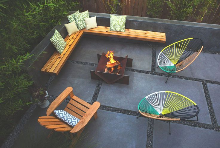 Modern backyard with wooden bench and metal outdoor fire for Outdoor modern fire pit