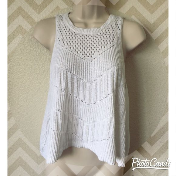 Awesome cropped knit top! Fun and casual knit top by American Eagle Outfitters! Flowy fit cropped top with high neckline and racerback.. Perfect for the warm weather! Size small American Eagle Outfitters Tops Crop Tops