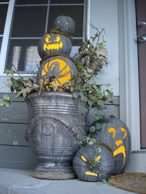 Love this idea! Carve pumpkins then paint them gray for this spooky look :] Or you could paint them first I suppose