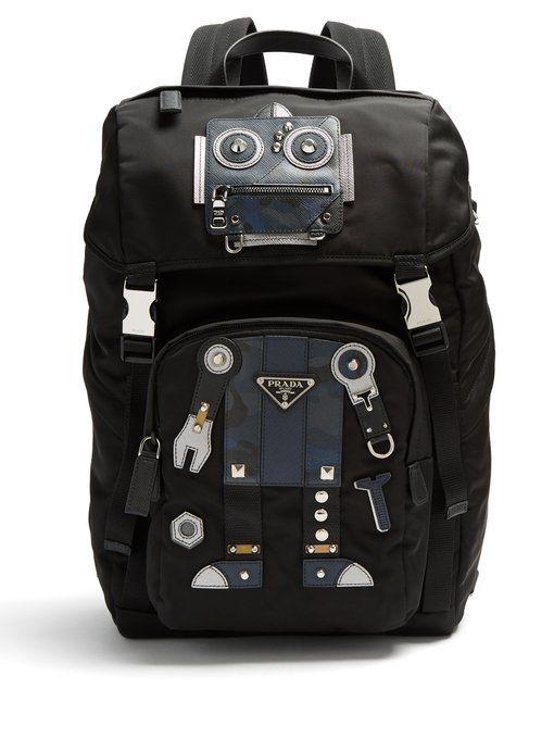 415cd7b055 PRADA Robot stud and leather-embellished nylon backpack.  prada  bags   leather  lining  nylon  backpacks