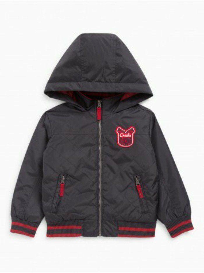 blouson enfant La Halle capuche avec logo rouge et fermetures eclair en rouge