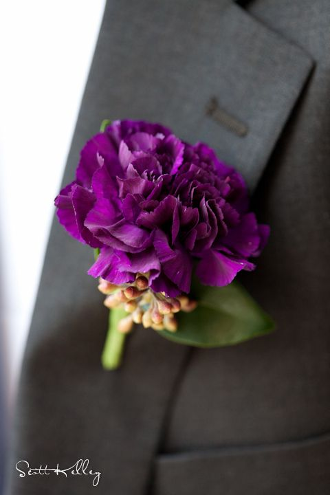 Purple carnation boutonniere. I am always a fan of the carnation because its sturdy and lasts such a long time.  Easy to work with for weddings or special occassions