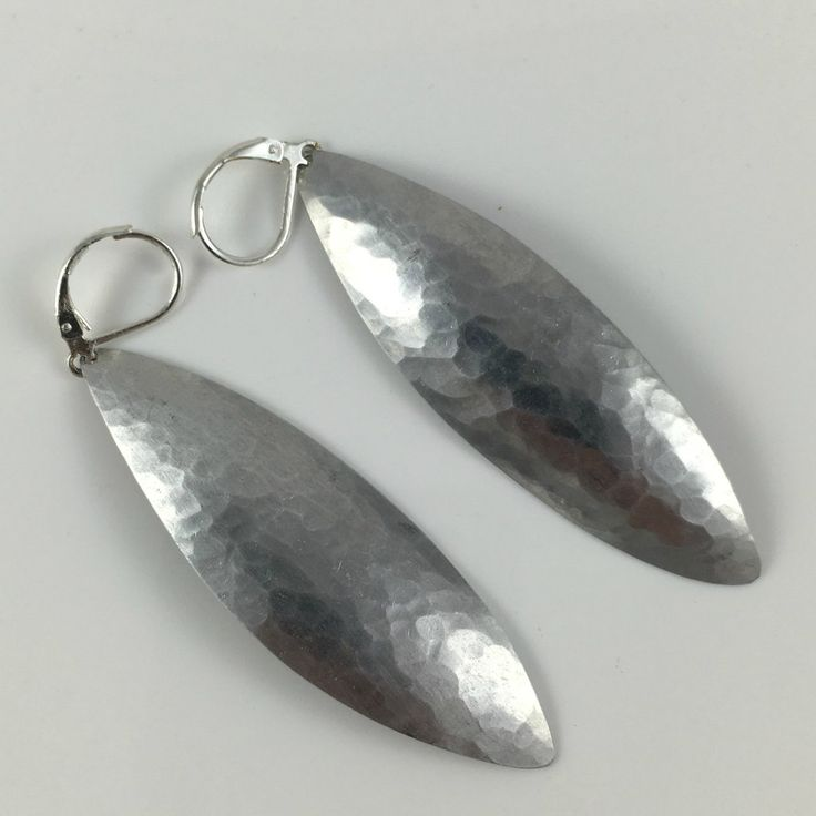 The 2.5-inch leaf reclaimed aluminum earrings handmade by G2G. Find them at www.explorelocaluniverse.com!