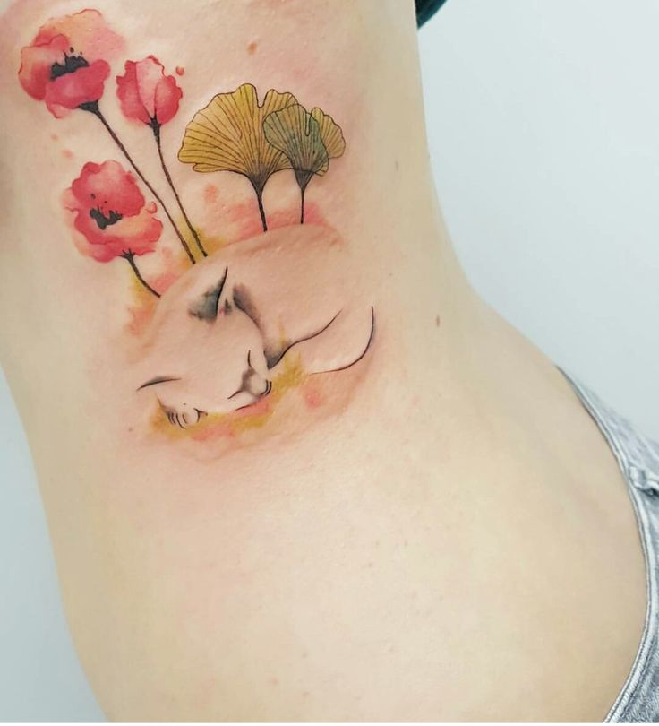 A Watercolour Tattoo by Jemka at Tora Sumi - Balmain, Sydney Australia. A Small Kitten Sleeps Amongst the Poppies and Gingko
