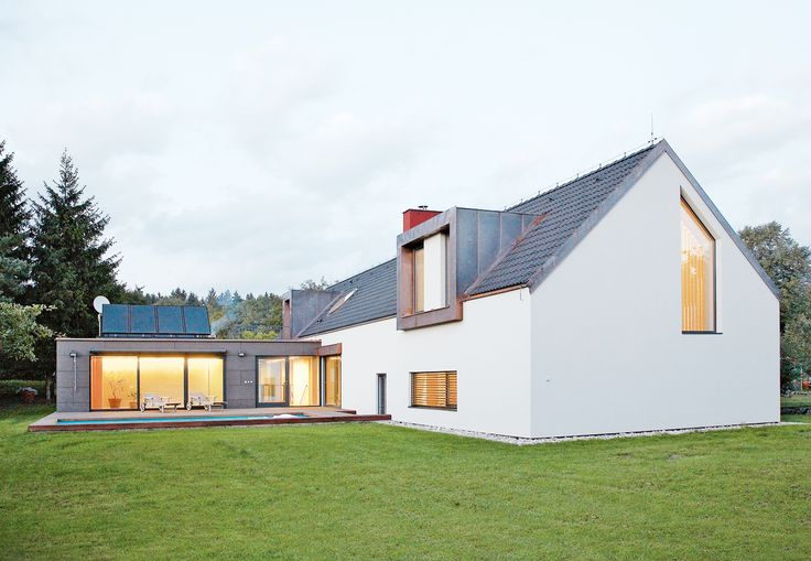 Taking a calculated turn from tradition, two Czech architects designed a modern rendition of a classic Bohemian home, powered by solar panels and a geothermal heat pump that draws energy from the ground itself, 300 feet underground.