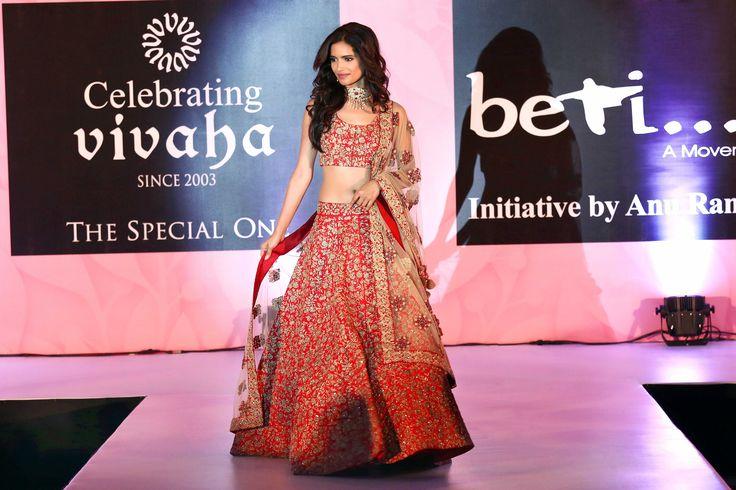 Vartika Singh walking the ramp for StudioAV by GauravnNitesh in this beautiful red lehenga