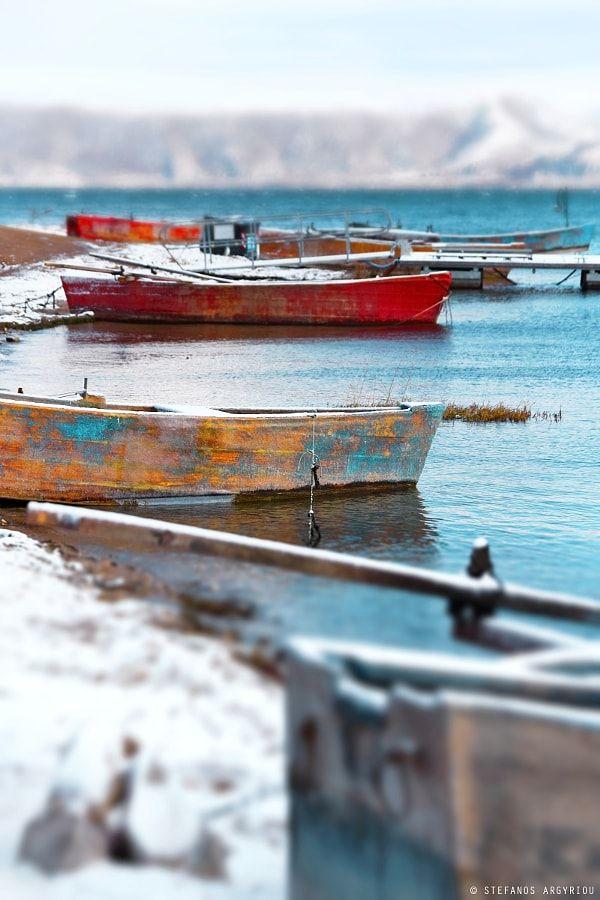 Boats on snowy Lake Vegoritida, Greece