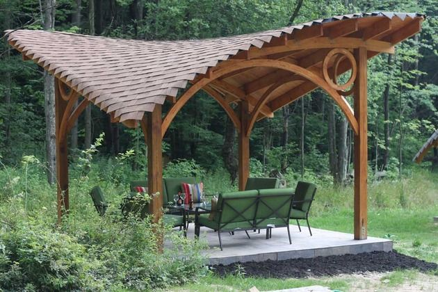 The Butterfly Gazebo features a curvaceous roof that resembles a wing and the additional details of round wood within the corners of the straight posts and curved beams makes this gazebo a beautifully and ethereal example of what can be accomplished with skilled woodworkers