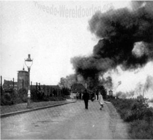 The battle of 's-Hertogenbosch, the capital of the provence Noord-Brabant, The Netherlands. The smoke was caused by the Germans blowing up a storage from the Luftwaffe. September 5th 1944.