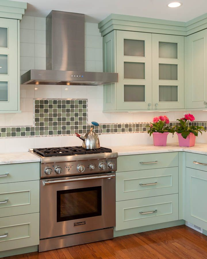 sea glass inlay in backsplash frosted glass cabinet doors