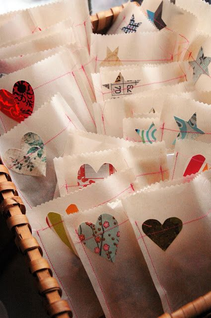 Inspiration: fold bags from white baking paper, use pinking sheers and sew on a patterned paper heart or star. From the stay lucky.