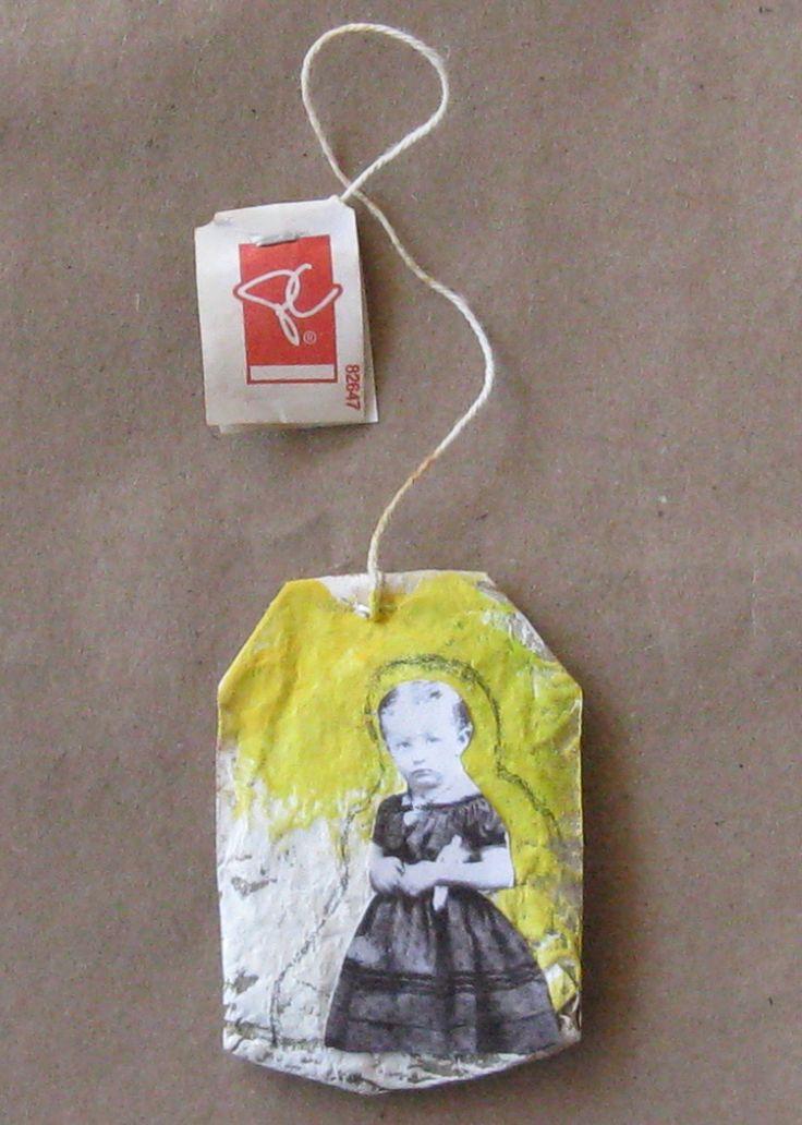 Collaging on a tea sachet...