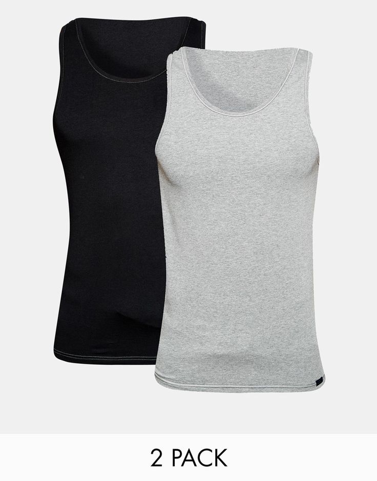 Trägershirt im Set von Esprit weiches Jersey U-Ausschnitt abgesetzte Nähte schmale Passform, sitzt eng am Körper Maschinenwäsche 80% Baumwolle, 20% Polyester Model trägt Größe M und ist 6 Fuß 2 Zoll/188 cm groß Zweierset