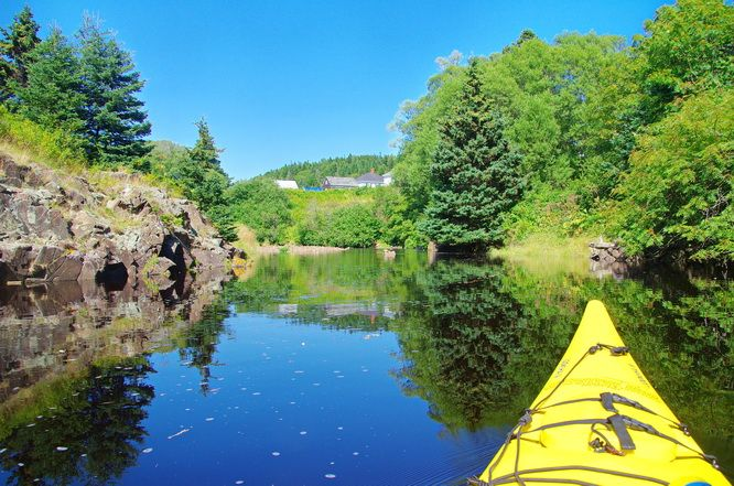 8 OUTSTANDING SUMMER ADVENTURES in NEW BRUNSWICK - Kayaking some of the calm waters around Grand Manan Island