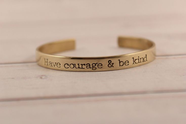 """This 1/4 x 6"""" brass cuff bracelet is hand stamped with """"Have Courage and Be Kind"""". As it was a sample, it is the only one available at this price. The band of the cuff measures 6 inches from end to en"""
