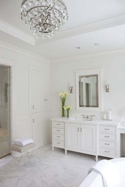 White bathroom with bling chandelier