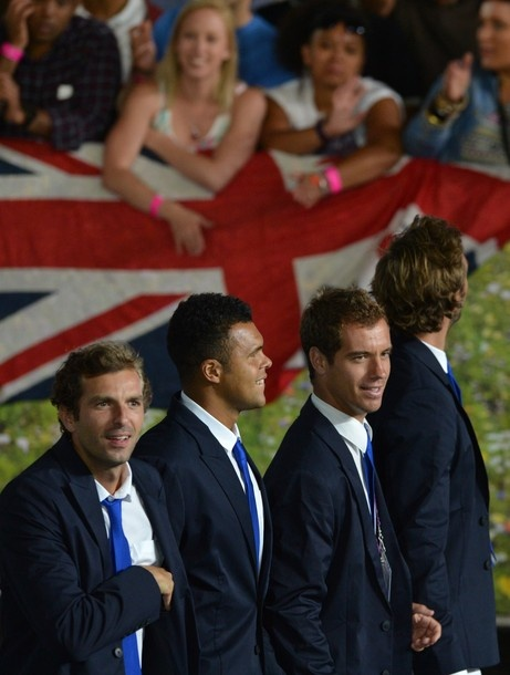 France's Julien Benneteau (L) and tennis players Jo-Wilfried Tsonga (C) and Richard Gasquet (2ndR) parade during the opening ceremony of the London 2012 Olympic Games on July 27, 2012 at the Olympic Stadium in London.