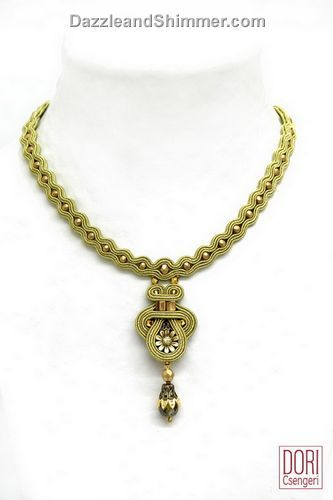 Neck Oriel embroidered pendant with/dangle by Dori Csengeri.