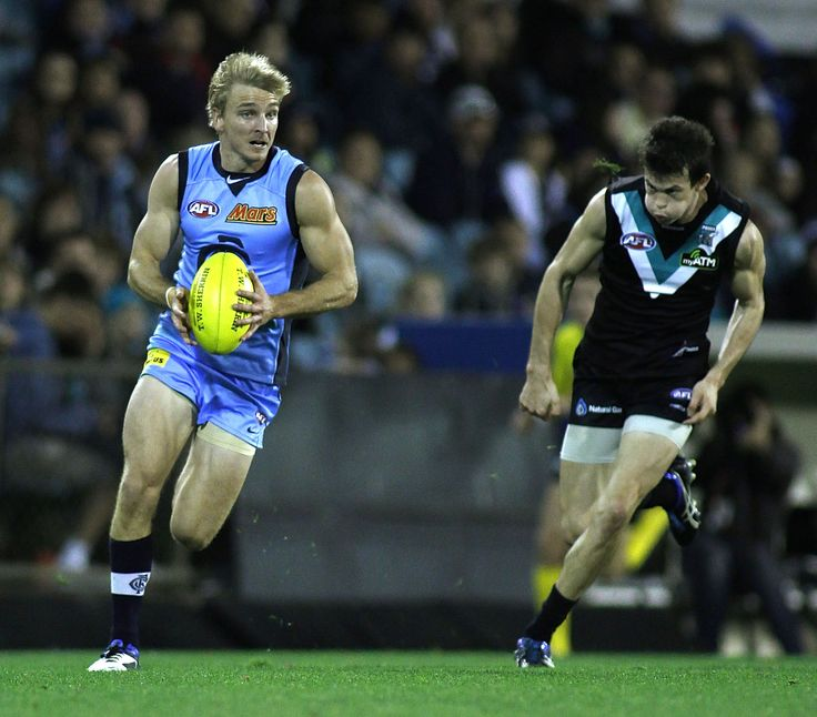 Trademark speed by Dennis leaves Jasper Pittard of Port Adelaide behind during the 2011 Round 11 match against Port Adelaide at AAMI Stadium.