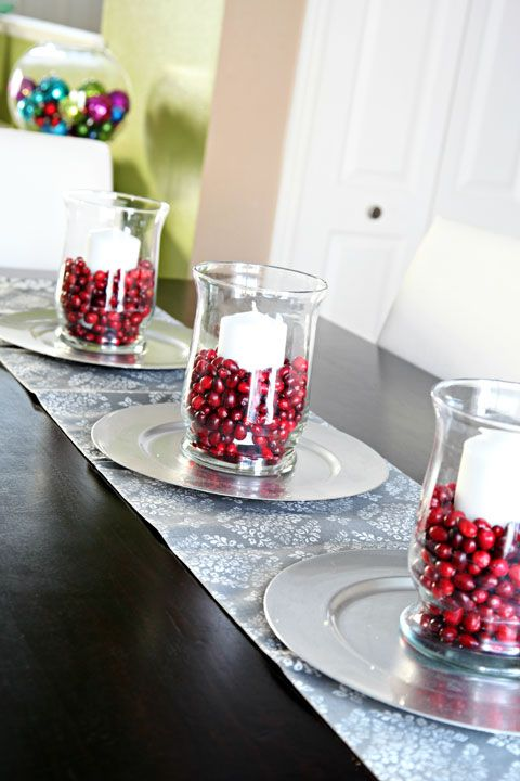 IHeart Organizing: Our 2012 Christmas Display.  Silver platters, cranberries, candles and glass vases....simple - elegant.