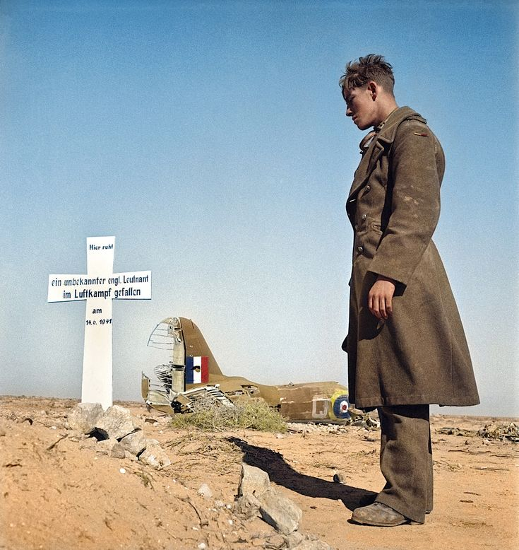 A German soldier buries an unknown English soldier that was killed in air combat in the Egyptian desert.
