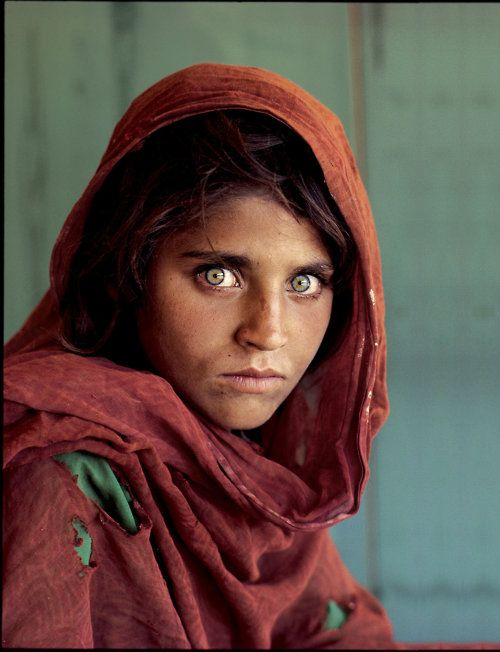 This was on the cover of National Geographic and the photographer who took the photo of the young girl with those haunting eyes, went back to find her after several years had passed.  He did...she was a wife and mother and identifiable by those eyes.