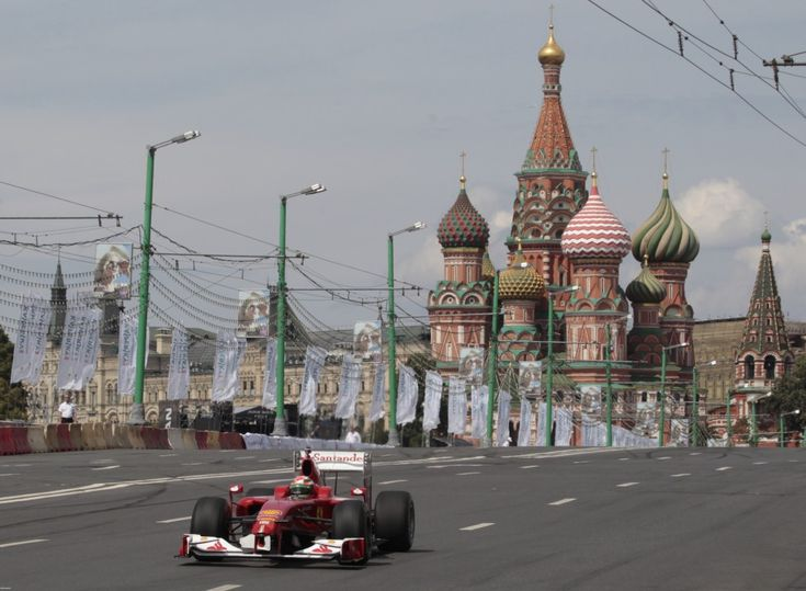 The Ferrari Formula One car piloted by Giancarlo Fisichella of Italy drives past St. Basil's during the Moscow City Racing event in Moscow, Russia. (Reuters)