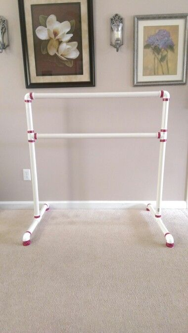 "DIY Ballet barre from PVC pipe Under $30!! All you need is two 10'x 1.25"" PVC pipes cut into  6 x 10"", 2 x 26"", 2 x 40"" 6 elbow connectors and  4  T - connectors I added decorative Duct tape for a special touch! =) Easy and took less than 30 min to assemble!"