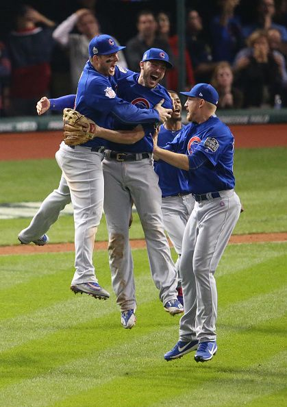 Chicago Cubs first baseman Anthony Rizzo and Chicago Cubs third baseman Kris Bryant leap together as they celebrate with their world champion Chicago...