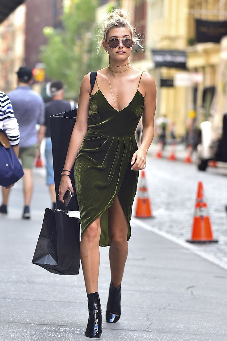Velvet: not just for winter. Take a note out of Hailey Baldwin's book and strip back your winter outfits to give a fresh spin on summer style. The best way to achieve this look? Plenty of skin on show, offset with some draped velvet and clompy boots.