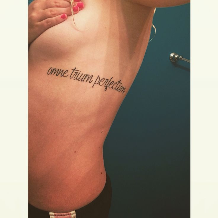 "Omne trium perfectum rib tattoo. For my beautiful angel. It means ""everything that comes in threes is perfect or complete"" for Down syndrome awareness"