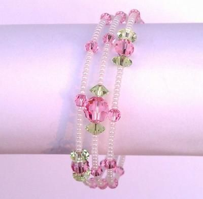 rose, peridot swarovski, white pearl seed beads on memory wire.