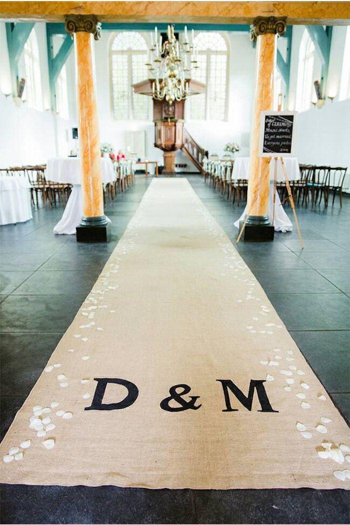 Monogram burlap aisle runner by ZahrazArt and 12 Beautiful Burlap Ideas for your rustic, country wedding on @intimatewedding #aislerunner #burlaprunner #wedding