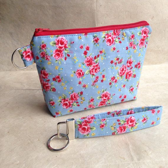 Purse and Key Fob Wristlet Keyring made with A beautiful floral cotton fabric The purse measures approximately 8x 6 with a 1.5 box bottom. It is