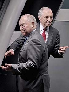A photo of two men in suits - Brian Griffin