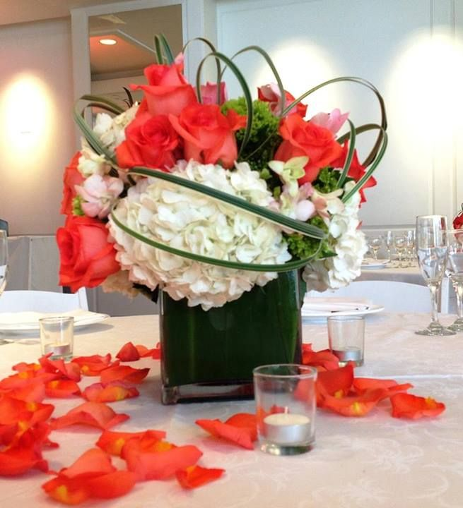Centerpiece low arrangement white hydrangeas coral