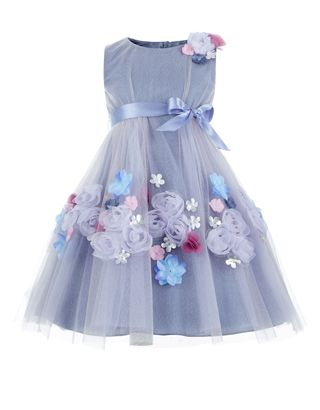 Our glittery Athia dress for girls is adorned with 3D rosettes and flower corsages, and cinched at the waist with a satin ribbon bow. This enchanting piece is crafted with a fitted bodice and a full skirt, and finished with a zip fastening on the reverse.