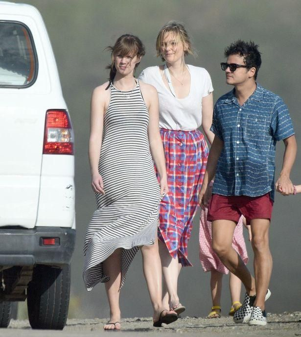 Sophie Dahl battles the wind in a floaty skirt during family beach trip with husband Jamie Cullum