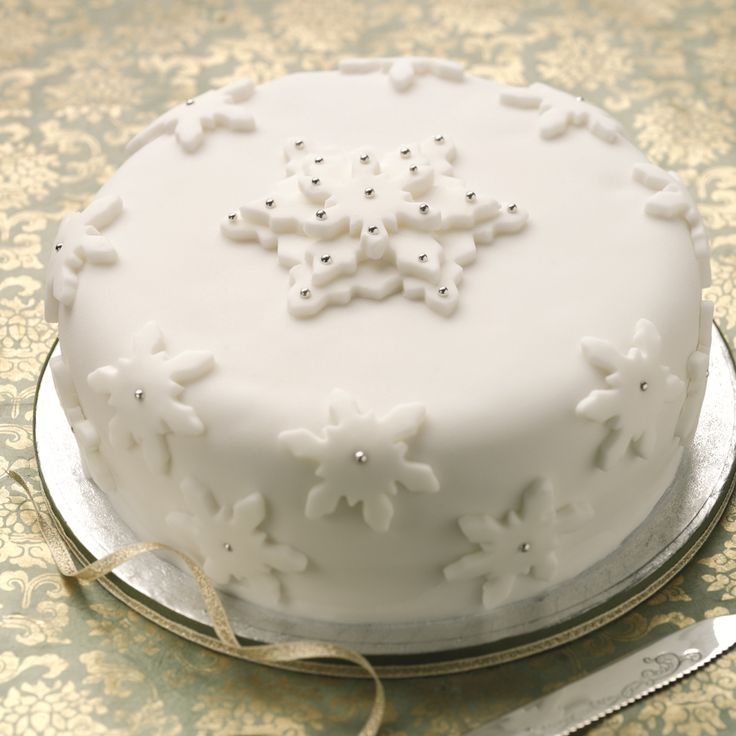 This Classic Christmas Cake Recipe is easy to make. Finish with traditional marzipan and icing for a chic, understated look.