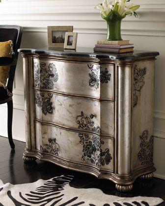 Hand-stenciled floral designs on silver metallic w/ gold-bronze trim & stained or dark wax finish; reeded bun feet; Blackstone laminate top w/ aluminum inlay