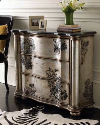 Hand-stenciled floral designs on silver metallic w/ gold-bronze trim & stained or dark wax finish; reeded bun feet; Blackstone laminate top w/ aluminum inlay