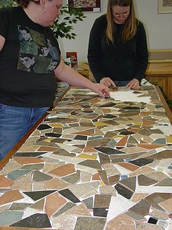 Easy directions on the site for doing your own mosaic tile tabletop. I plan on doing this with my coffee table!