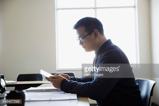 Stock Photo : Adult education student using digital tablet in classroom