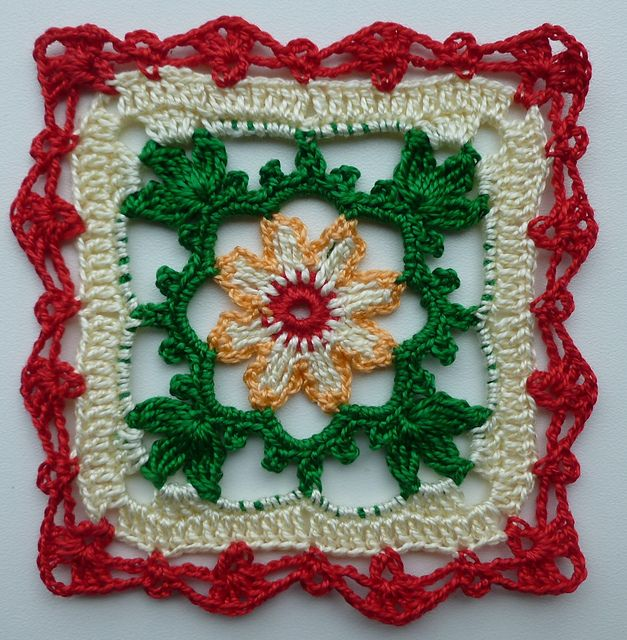 Lacy square in Christmas colors.  One of the prettiest squares I've seen.  I Love the edging.