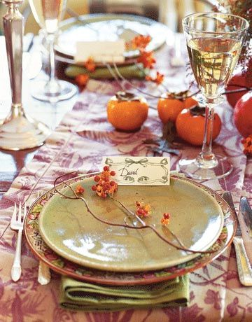 I like the simplicity of this... simple branches and persimmons with a decorative runner.