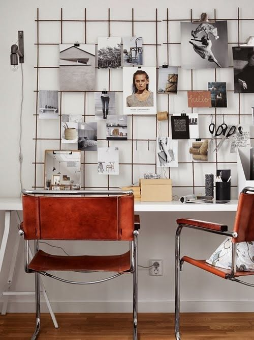 Home office with leather chairs and a great moodboard wall. A very cool Swedish home with a twist.