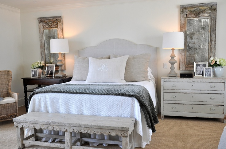 Calm. Love the large, mismatched bedside tables and the unique shape of the padded headboard. The pier mirrors are gorgeous.