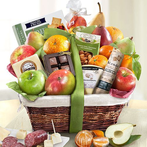 This grand-sized classic basket of orchard favorite fruits are accompanied by two natural cheeses, an italian style sausage, chocolate-covered sea salt caramels, premium almonds, dried fruit and olive