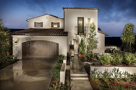A beautifully landscaped courtyard welcomes you to Plan 2, a new home built by Brookfield Residential SoCal. The Brookfield Sentinels at Del Sur community. San Diego, CA.